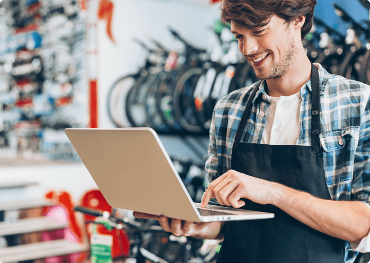 Bike-shop-owner-with-laptop-901074626_5760x3840